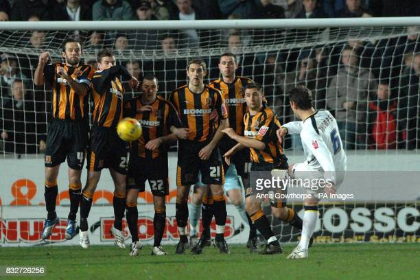 Leeds' Alan Thompson curls the ball around the wall to score Leeds' second goal during the CocaCola Championship match at the KC Stadium Hull