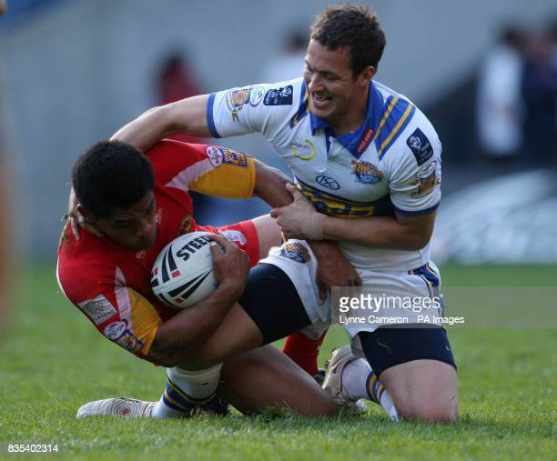 Leeds' Danny McGuire and Catalan Dragons Dimitri Pelo during the engage Super League Magic Weekend match at Murrayfield Stadium