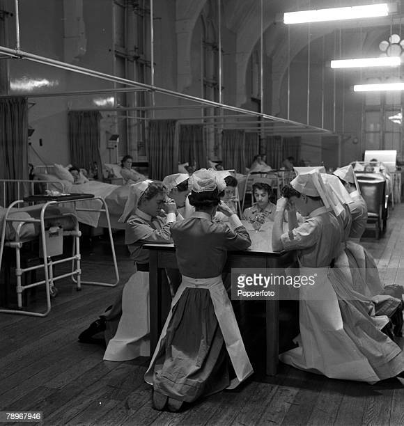 Leeds England A group of nurses kneel to pray before the start of a day's work in the women's medical ward