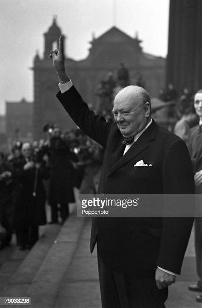 Leeds England Winston Churchill Conservative politician and British Prime Minister between the years 194045 and 195155 is pictured waving to crowds...