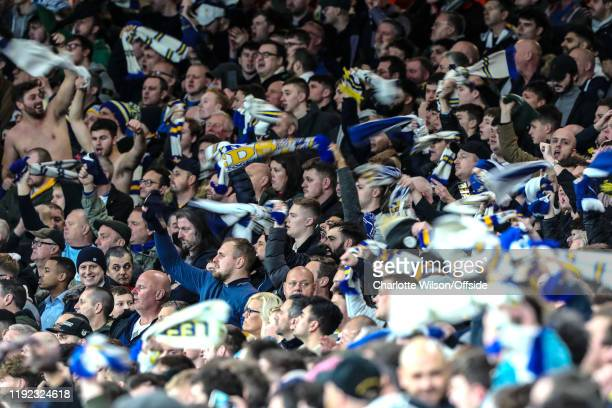Leeds fans wave their scarves during the FA Cup Third Round match between Arsenal and Leeds United at Emirates Stadium on January 6 2020 in London...