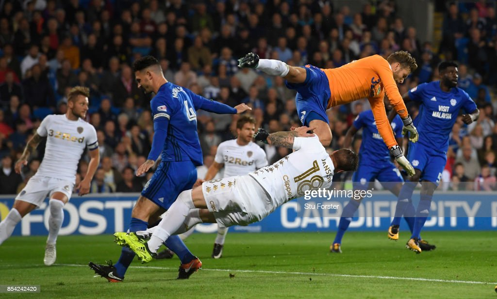 Leeds goalkeeper Felix Wiedwald catches his own player Pontus Jansson whilst clearing a corner during the Sky Bet Championship match between Cardiff City and Leeds United at Cardiff City Stadium on September 26, 2017 in Cardiff, Wales.