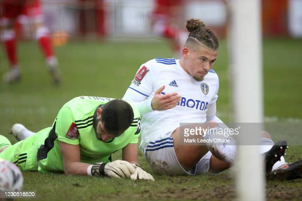 Leeds goalkeeper Kiko Casillo and Kalvin Phillips of Leeds sit dejected in the mud after the third Crawley goal during the FA Cup Third Round match...