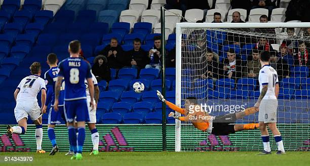 Leeds goalkeeper Marco Silvestre makes a diving save during the Sky Bet Championship match between Cardiff City and Leeds United at Cardiff City...