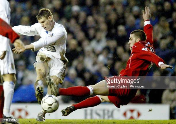 Leeds' James Milner tries to get a shot past Middlesbrough's Andrew Davies during their Barclaycard Premiership match at Elland Road West Yorkshire...