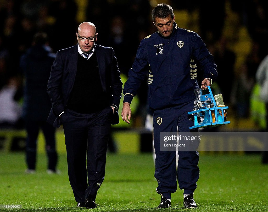 Leeds manager Brian McDermott (L) looks dejected after his side lost the Sky Bet Championship match between Watford and Leeds United at Vicarage Road on April 8, 2014 in Watford, England.