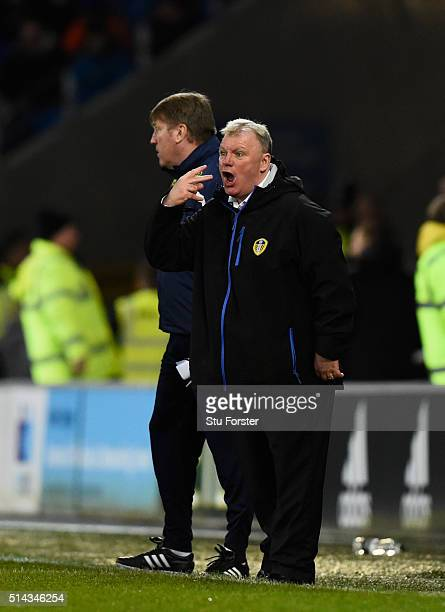 Leeds manager Steve Evans and his assistant Paul Raynor react during the Sky Bet Championship match between Cardiff City and Leeds United at Cardiff...