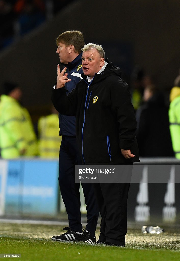 Leeds manager Steve Evans (r) and his assistant Paul Raynor react during the Sky Bet Championship match between Cardiff City and Leeds United at Cardiff City Stadium on March 8, 2016 in Cardiff, United Kingdom.