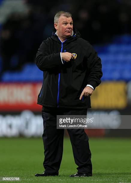 Leeds manager Steve Evans points to the badge on his chest after the Emirates FA Cup Fourth Round match between Bolton Wanderers and Leeds United at...