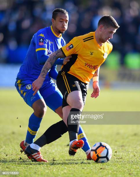 Leeds player Cameron Borthwick Jackson challenges Scott Bennett of Newport during The Emirates FA Cup Third Round match between Newport County and...
