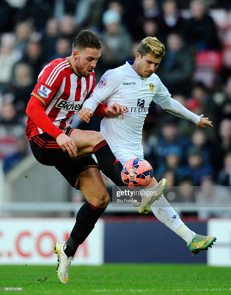 Leeds player Gaetano Berardi (r) battles for the ball against Connor Wickham of Sunderland during the FA Cup Third Round match between Sunderland and Leeds United at Stadium of Light on January 4, 2015 in Sunderland, England.