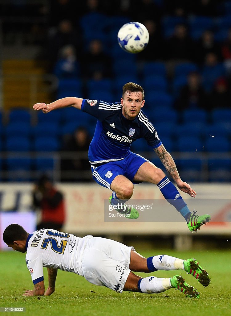 Leeds player Liam Bridcutt (l) is challenged by Joe Ralls during the Sky Bet Championship match between Cardiff City and Leeds United at Cardiff City Stadium on March 8, 2016 in Cardiff, United Kingdom.