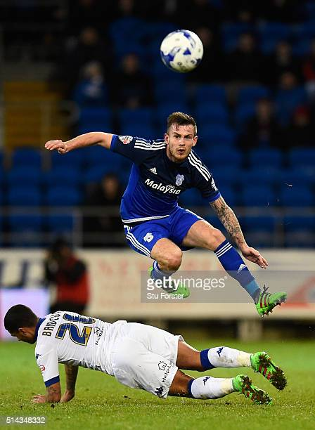 Leeds player Liam Bridcutt is challenged by Joe Ralls during the Sky Bet Championship match between Cardiff City and Leeds United at Cardiff City...