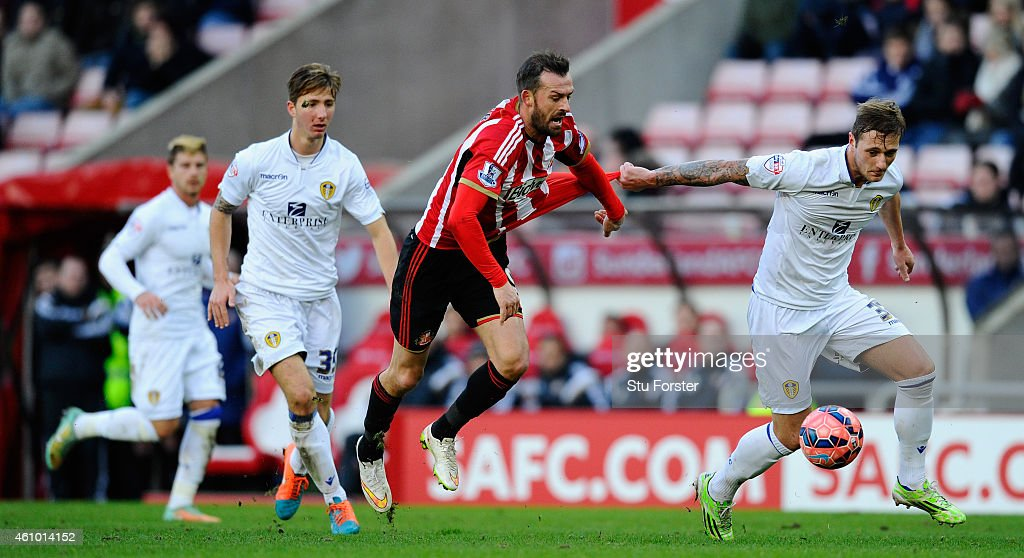 Leeds player Liam Cooper (r) battles for the ball against Steven Fletcher of Sunderland during the FA Cup Third Round match between Sunderland and Leeds United at Stadium of Light on January 4, 2015 in Sunderland, England.