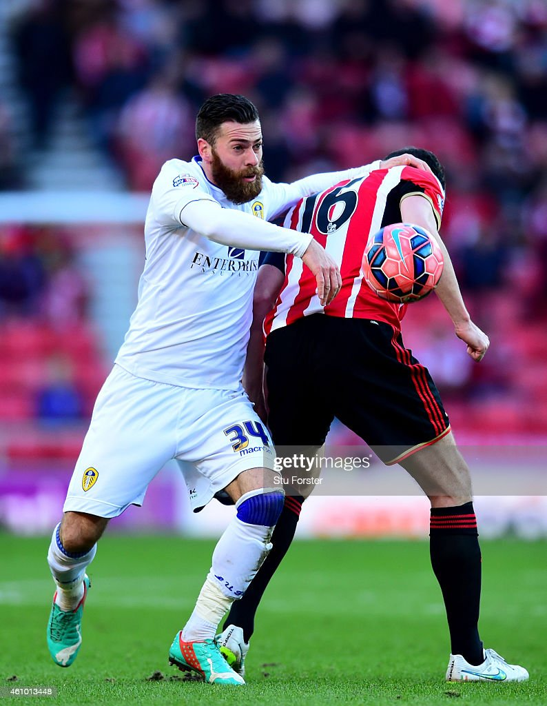 Leeds player Mirco Antenucci (l) battles in vain for the ball against John O' Shea during the FA Cup Third Round match between Sunderland and Leeds United at Stadium of Light on January 4, 2015 in Sunderland, England.