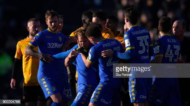 Leeds player Samuel Saiz is held back by team mates after being red carded during The Emirates FA Cup Third Round match between Newport County and...