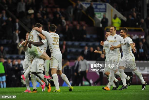Leeds players celebrate after beating Burnley on penalties during the Carabao Cup Third Round match between Burnley and Leeds United at Turf Moor on...