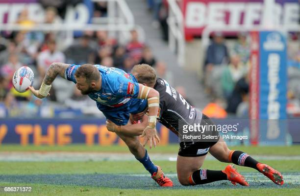 Leeds Rhinos Adam Cuthbertson offloads as he is tackled by Castleford Tigers' Paul McShane during day two of the Betfred Super League Magic Weekend...