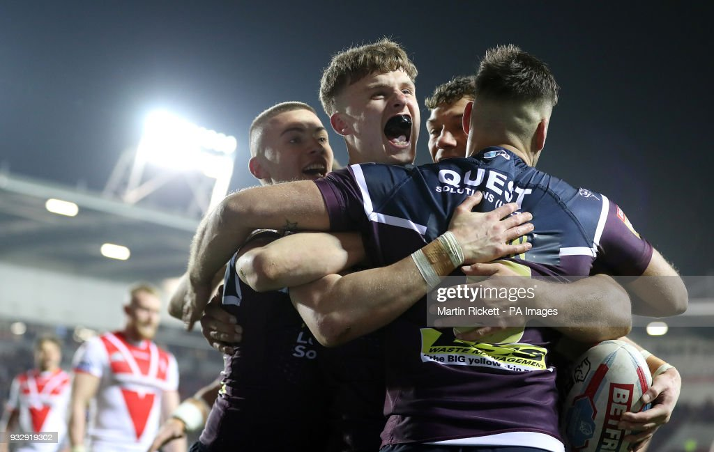 Leeds Rhinos Ash Handley (second left) celebrates scoring his second try against St Helens, during the Betfred Super League match at The Totally Wicked Stadium, St Helens.