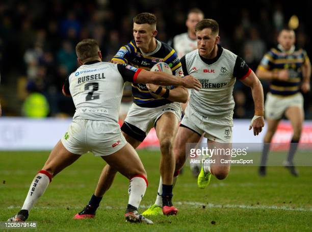Leeds Rhinos' Ash Handley is tackled Toronto Wolfpack's Matty Russell during the Betfred Super League match between Leeds Rhinos and Toronto Wolfpack...