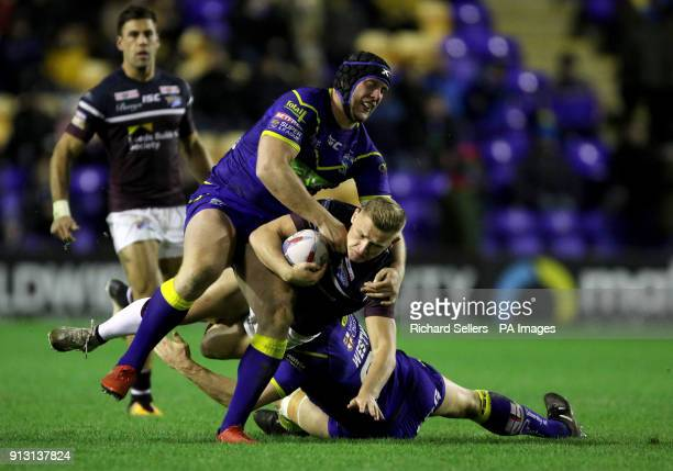 Leeds Rhino's Brad Dwyer is tackled by Warrington's Chris Hill and Ben Westwood during the Betfred Super League match at the Halliwell Jones Stadium...