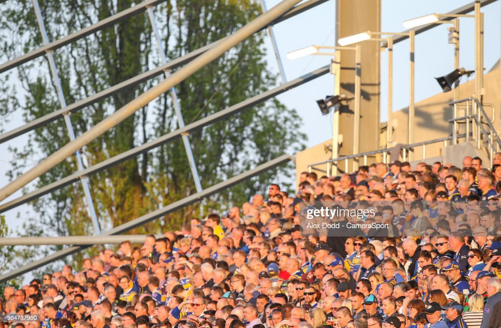 Leeds Rhinos fans watch on during the first half during the Betfred Super League Round 14 match between Leeds Rhinos and Warrington Wolves at Headingley Carnegie Stadium on May 4, 2018 in Leeds, England.
