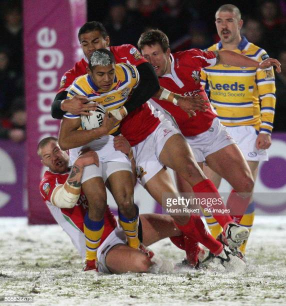 Leeds Rhinos' Kallum Watkins is tackled by Celtic Crusaders' Jordan James and Frank Winterstein during the Engage Super League match at the...