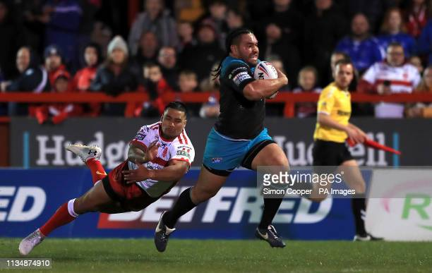 Leeds Rhinos' Konrad Hurrell breaks away to score his sides first try if the game during the Betfred Super League match at Craven Park, Hull.