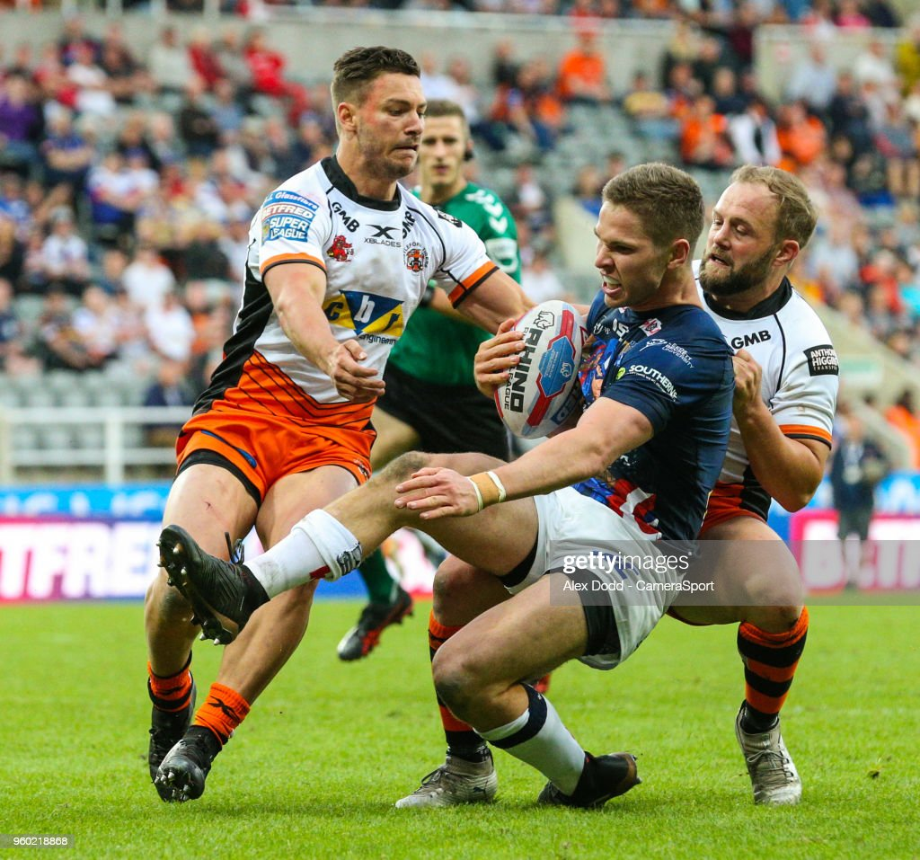 Leeds Rhinos' Matt Parcell is stopped short of the line by Castleford Tigers' Jv Hitchcox and Paul McShane during the Betfred Super League Round 15 match between Castleford Tigers and Leeds Rhinos at St James' Park on May 19, 2018 in Newcastle upon Tyne, England.
