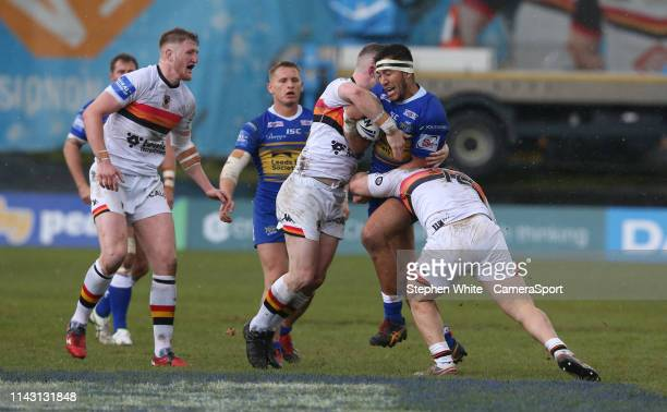 Leeds Rhinos' Nathaniel Peteru is tackled by Bradford Bulls' Sam Hallas and Connor Farrell during the Rugby League Coral Challenge Cup Sixth Round...