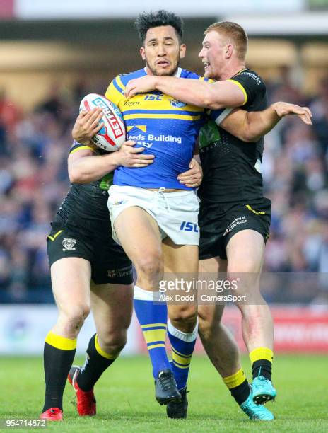 Leeds Rhinos' Nathaniel Peteru is tackled by Warrington Wolves 's Jack Hughes and Chris Hill during the Betfred Super League Round 14 match between...