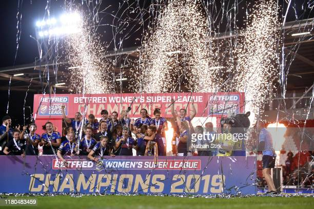 Leeds Rhinos players celebrate after they win the Betfred Womens Supper League cup after the Betfred Womens Super League Grand Final match between...
