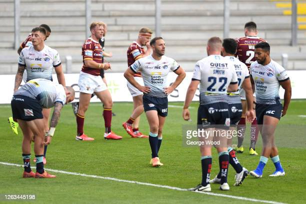 Leeds Rhinos players react during the Betfred Super League match between Huddersfield Giants and Leeds Rhinos at Emerald Headingley Stadium on August...