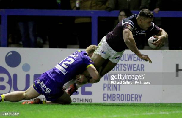 Leeds Rhino's Ryan Hall dives over to score as Warrington's Jack Hughes tackles during the Betfred Super League match at the Halliwell Jones Stadium...