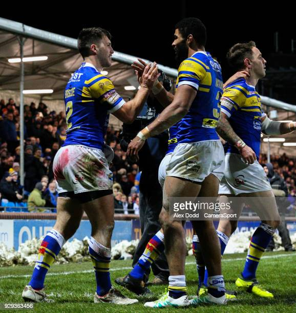 Leeds Rhinos' Tom Briscoe celebrates scoring his side's second try with Kallum Watkins during the Betfred Super League Round 5 match between Leeds...