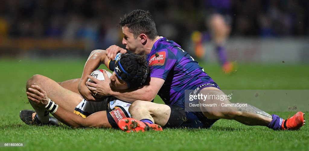 Leeds Rhinos's Ashton Golding is tackled by Wigan Warriors' Morgan Escare during the Betfred Super League Round 7 match between Leeds Rhinos and Wigan Warriors at Headingley Carnegie Stadium on March 31, 2017 in Leeds, England.