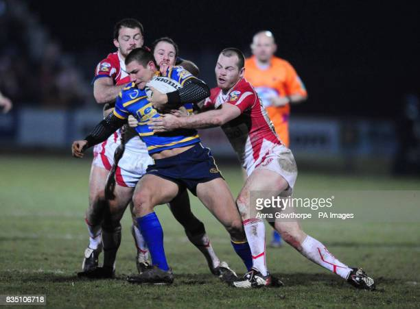 Leeds Rhinos's Ryan Hall is held by the Hull KR defence during the engage Super League match at the KC Stadium Hull