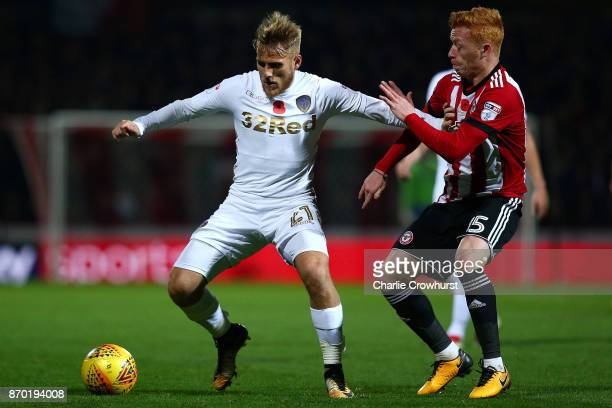 Leeds Samuel Saiz holds off the challenge from Brentford's Ryan Woods during the Sky Bet Championship match between Brentford and Leeds United at...