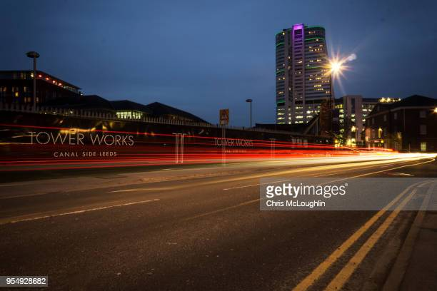 leeds skyline with light trails - leeds skyline stock photos and pictures