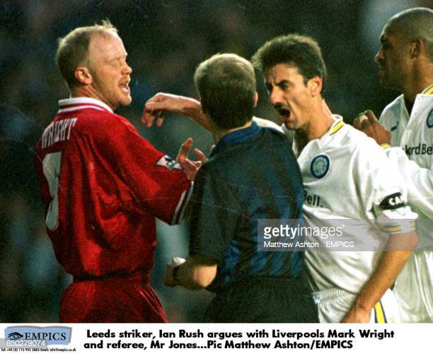Leeds striker Ian Rush argues with Liverpool's Mark Wright and referee Mr Peter Jones
