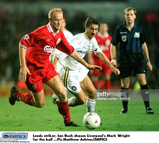 Leeds striker Ian Rush chases Liverpool's Mark Wright for the ball