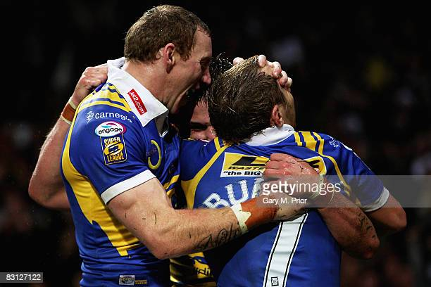 Leeds try scorer Lee Smith is congratulated by teamates Scott Donald and Rob Burrow after scoring his team's opening try during the engage Super...
