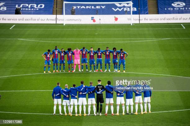 Leeds United and Crystal Palace players observe a minute's silence to mark Armistice Day, from left: Andros Townsend, Cheikhou Kouyate, Nathaniel...