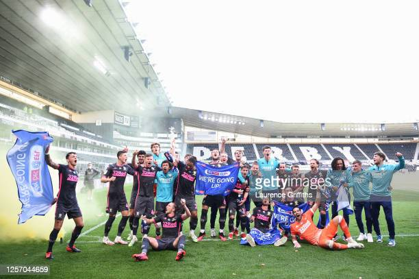 Leeds United celebrate winning the league and promotion to the premier league during the Sky Bet Championship match between Derby County and Leeds...