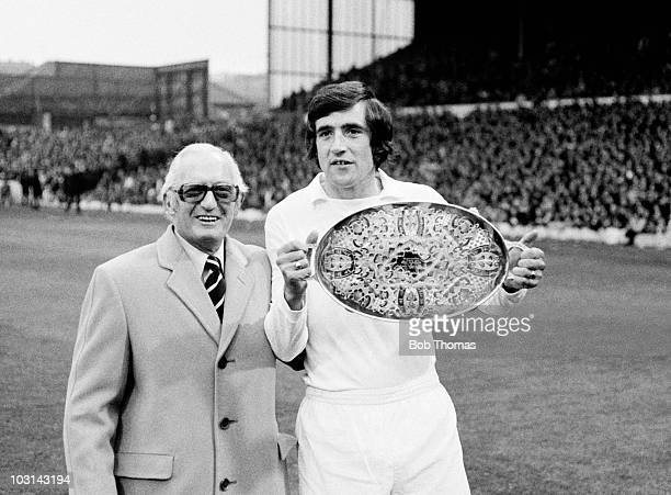 Leeds United Chairman Manny Cussins with long serving defender Norman Hunter prior to their First Division match against Liverpool at Elland Road in...