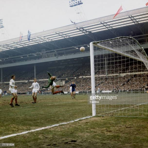 Leeds United defenders Norman Hunter and Jack Charlton watch as a shot goes over Leeds goalkeeper Gary Sprake during their FA Cup Final appearance...
