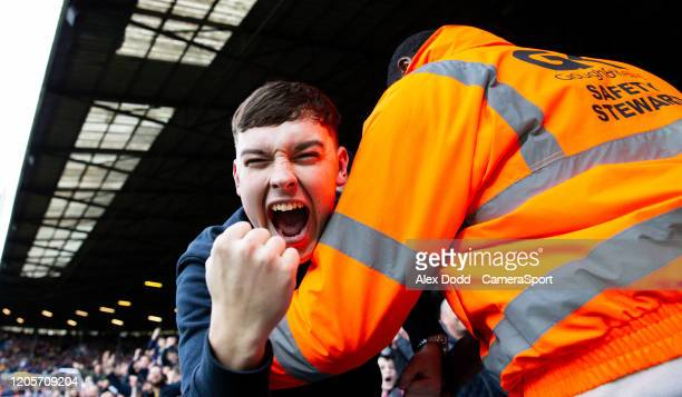 Leeds United fan celebrates the opening goal during the Sky Bet Championship match between Leeds United and Huddersfield Town at Elland Road on March...