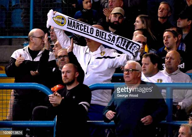Leeds United fan with a Marcelo Bielsa scarf looks on during the Carabao Cup Second Round match between Leeds United and Preston North End at Elland...