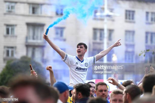 Leeds United fans celebrate after winning the Sky Bet Championship title at Millennium Square on July 19, 2020 in Leeds, England.