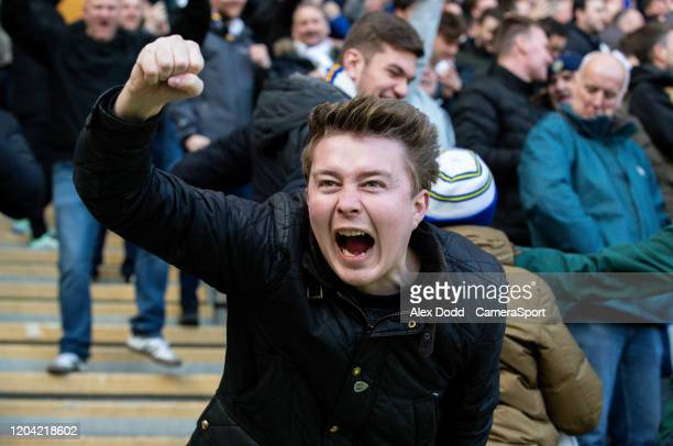 Leeds United fans celebrate during the Sky Bet Championship match between Hull City and Leeds United at KCOM Stadium on February 29 2020 in Hull...
